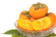 Raccolto della frutta del cachi Immagine Stock
