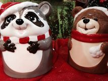 Raccoon and bear cookie jars Stock Photography