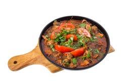 Raccordo stufato delizioso della carne di maiale con i pomodori freschi Immagine Stock Libera da Diritti