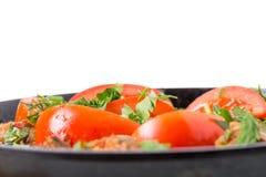 Raccordo stufato delizioso della carne di maiale con i pomodori freschi Fotografie Stock