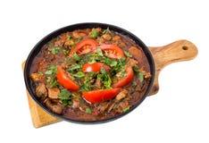 Raccordo stufato delizioso della carne di maiale con i pomodori freschi Immagine Stock