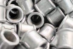 Raccords de placer pour des tuyaux en métal Images stock