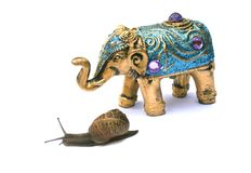 The Race Is On. Bejewelled Indian Elephant Ornament and real slug which was on Eliphants back before it realized it was going no where, silk threads can be seen stock photo