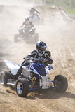 Race. Quad motorcycles racing in the road-metal stock images