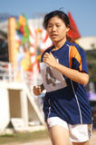 The race. A girl runs along the track as she races to the finish line stock image