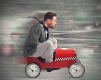 Race against time. Businessman in a constant race against time Royalty Free Stock Photography