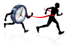 Race Against Time. A man running racing against a clock character beating it to the finish line Stock Photography