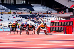 Race of athletes on wheelchairs. Athletes at the Visa London Disability Athletics Challenge at the Olympic Stadium in London on May 8, 2012. The event is part of Stock Images