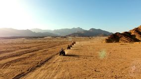 Race on the ATV in the desert. Home bedouin Stock Images