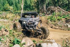 Race ATV in the mud, off road royalty free stock images