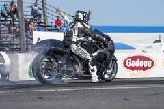 Race bike making a burnout on the track Royalty Free Stock Photo