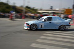 Race car. Blured race car in action royalty free stock image