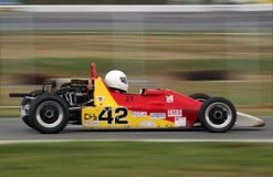 Race Car. Open wheel race car shot with panning motion Royalty Free Stock Image