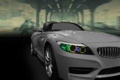 Race car. Modern race car with blurred city background Stock Photos