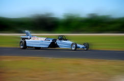 Race car. Blue Formula One race car at high speed with motion blur Stock Image