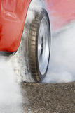 Race car burns rubber for the race Royalty Free Stock Photo