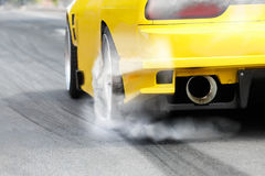 Race car burns tires for the race. Race car burns rubber off its tires in preparation for the race stock photo