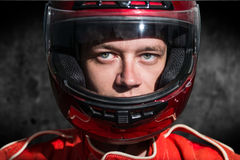 Race car driver wearing protective helmet. Closeup race car driver wearing protective helmet Stock Image