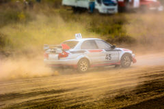 Race car on a dusty road. The competition in autocross, muddy dirt track stock photo