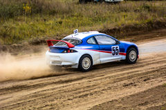 Race car on a dusty road Royalty Free Stock Images