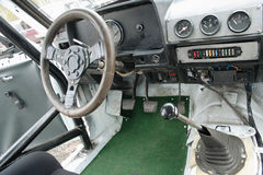 Race car interior. Drivers side steering wheel and controls in the interior of an old race car Stock Photography