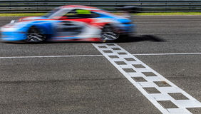 Race car racing on speed track Royalty Free Stock Photos