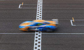 Race car racing on speed track Stock Photography