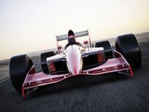 Race car racing on a track. Front view with motion blur Royalty Free Stock Image