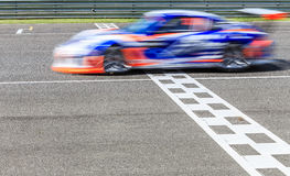Race car racing. On a track with motion blur stock photography