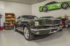 Race cars in a garage Stock Photography