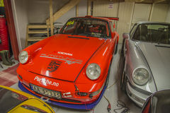 Race cars in a garage Royalty Free Stock Photography