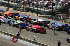 Race cars lined up on track Royalty Free Stock Photo