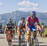 The Race. Col de Manse, France- July 16, 2013: The French cyclist  Sylvain Chavanel ( Omega Pharma-Quick Step Team) try to pass by the French cyclist John Gadret Stock Photo