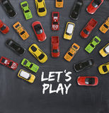 Race or competition concept with toy cars on blackboard Royalty Free Stock Images