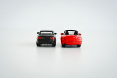 Race or competition concept with toy cars on white background Stock Photos