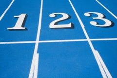 race för blålinjen som en startar tre spår två Arkivbild
