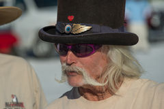 Race fan at Bonneville Speedway. A race fan with a handlebar mustache and wearing a top hat seen at the Bonneville Speedway, Utah in August 2013 Stock Photos
