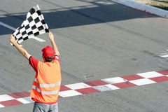 Race flag. Man with race flag on finish Stock Image