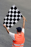 Race flag. Man with race flag on finish Stock Photos