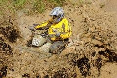 Race four-wheeler rider Stock Images