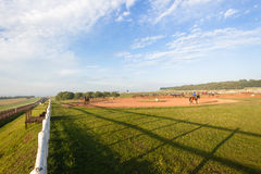 Race Horses Riders Training Landscape. Race Horses riders morning training at Summerveld outside Durban South-Africa Royalty Free Stock Photo