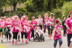 Race for Life sponsored fun run. Liverpool, UK - June 26, 2016: Race for Life sponsored fun run for British charity Cancer Research UK. The race is on, Groups stock photography