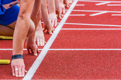 Race line. Runners gather on the start line for sprint Royalty Free Stock Image