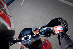 Motorcycle action. Race motorcycle in action, traveling on road Stock Images