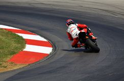 Race motorcycle team. High performance race bake rides the sharp turn stock images