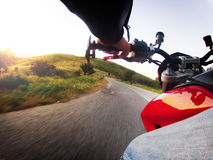 Motorcycle action. Race motorcycle with traveling in forest road Royalty Free Stock Images