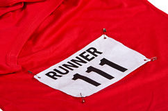 Race number on running shirt Royalty Free Stock Images