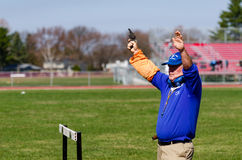 Race Official Shoots Starting Gun. Race official shoots gun to start high school Track and Field race in Albany, NY Stock Photos