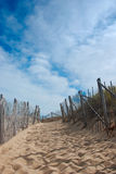 Race Point Footpath. Sandy beach footpath between snow fencing up a hill and between sand dunes Royalty Free Stock Photography