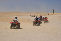 Race on quad in desert Royalty Free Stock Images